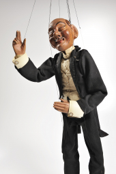 A puppet of an older gentleman.